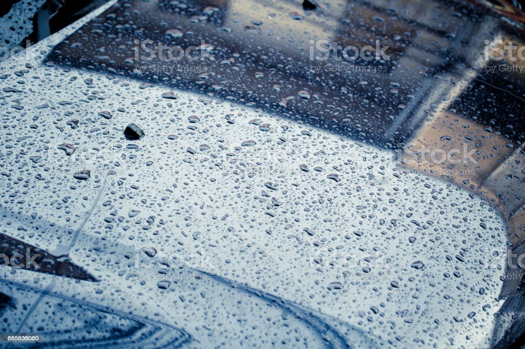 0f55f447a99b8 Car Hood with rain drop wet clean dark storm color tone in raining season.  - Stock image .
