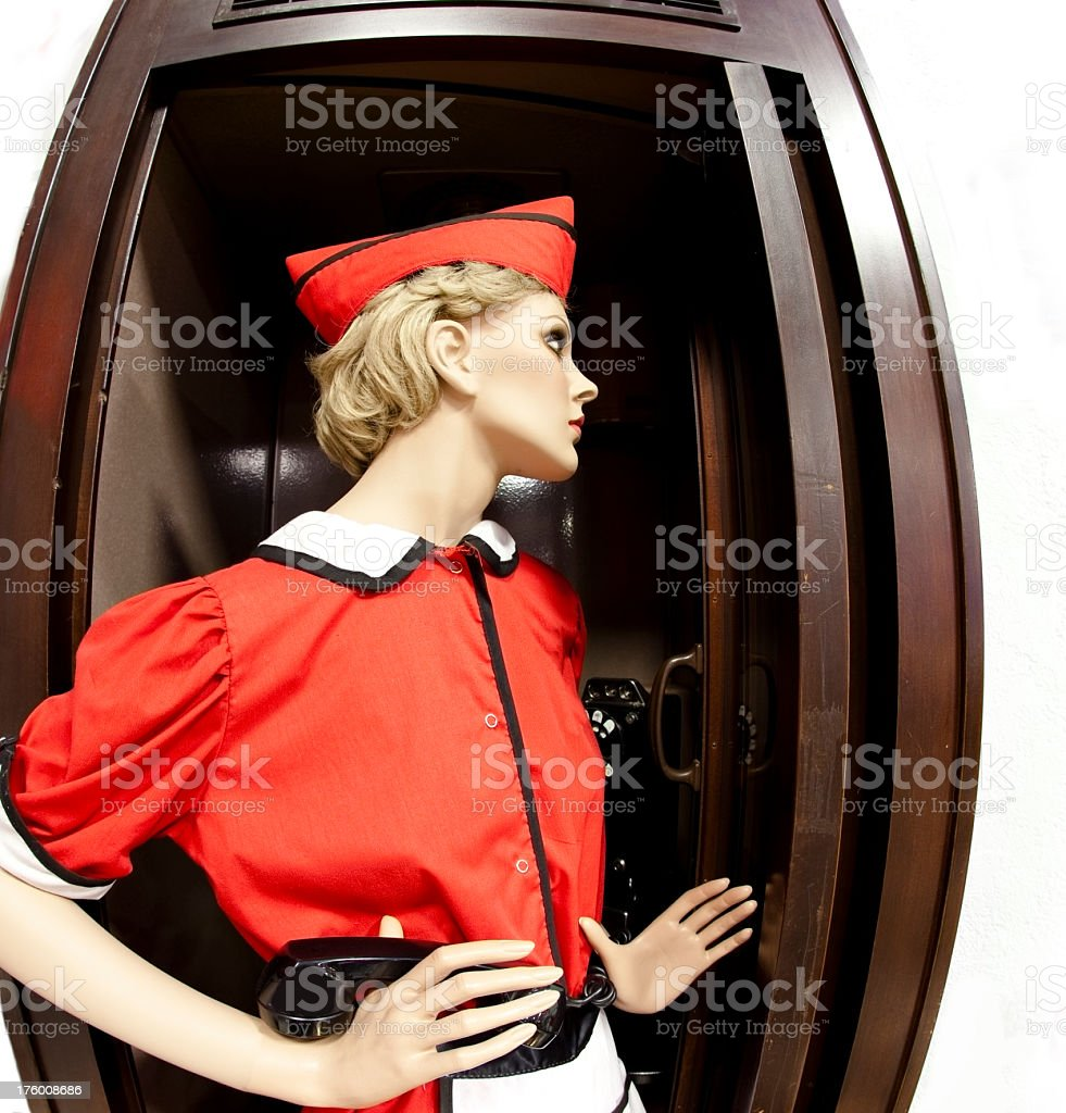 Car Hop mannequin in old telephone booth stock photo