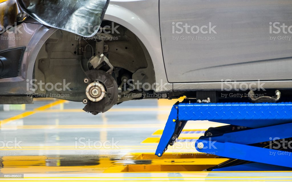 Car hub front lifting scissors in garage stock photo
