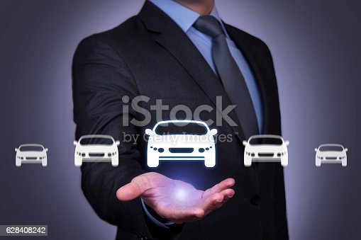 683425144 istock photo Car Icons over Human Hand 628408242