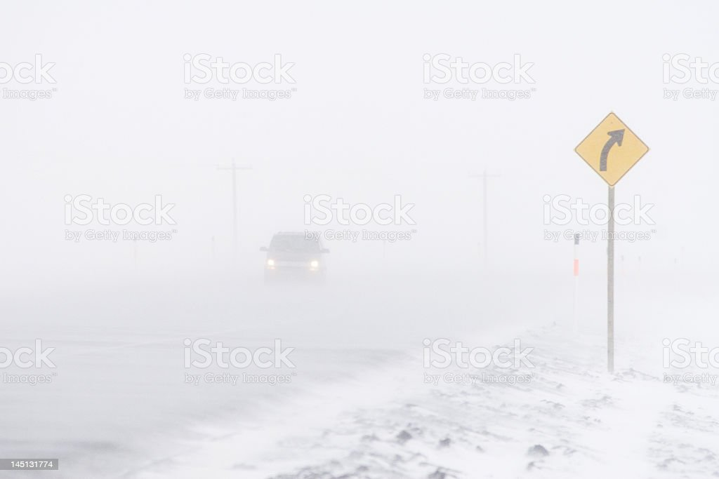 Car in a Blizzard royalty-free stock photo