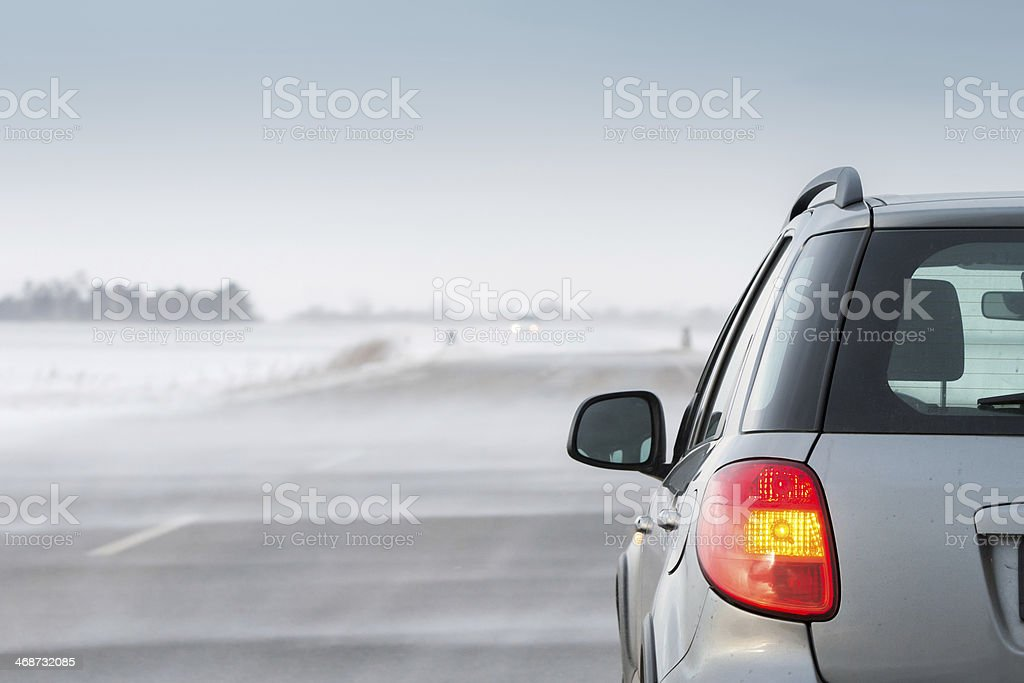 Car in a blizzard stock photo