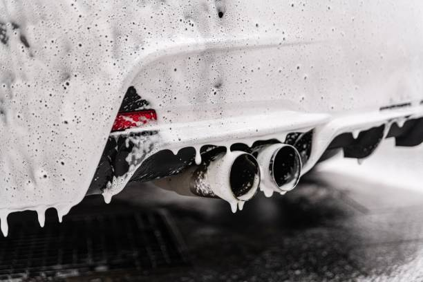 Car in a car wash covered with foam stock photo