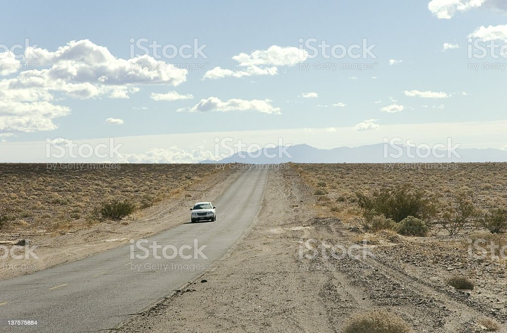 Car in a lonely road royalty-free stock photo