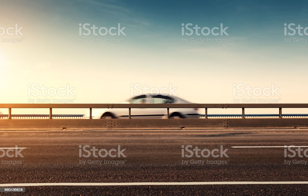 Car in blurred motion on the road stock photo