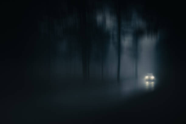 car in country road with fog and low visibility. Blur added stock photo