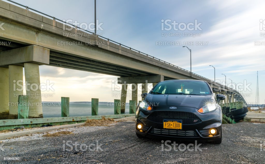 Car in front of a bridge stock photo