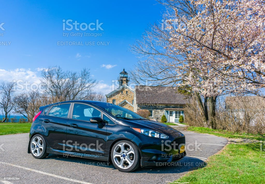 Car in front of a light house stock photo