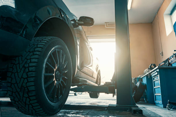 car in garage of auto repair service shop with special repairing equipment, changing tires - brake service stock photos and pictures