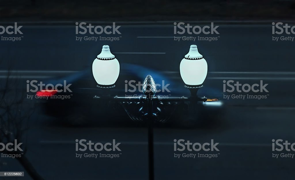 Car in motion and evening lights stock photo