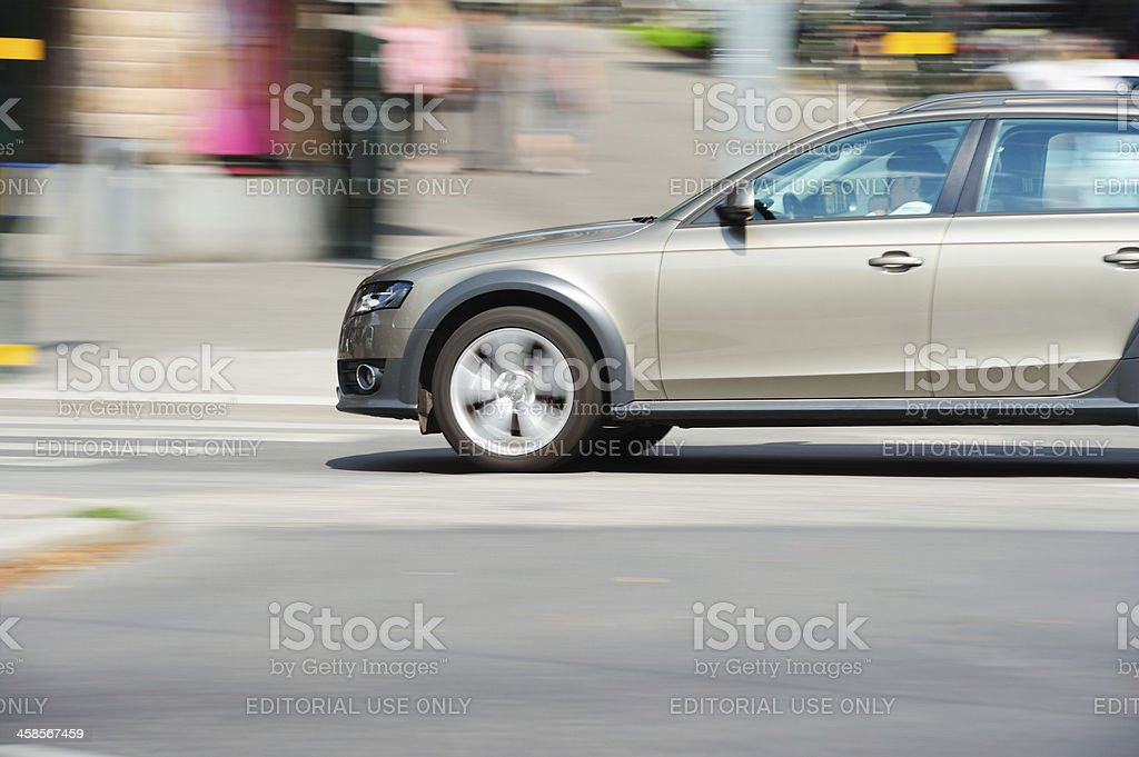 Car in motion on city streets royalty-free stock photo