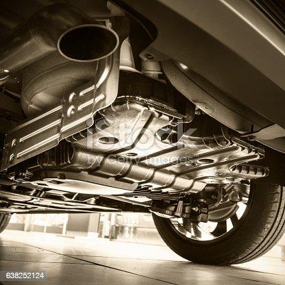 istock Car in repair shop view from below 638252124