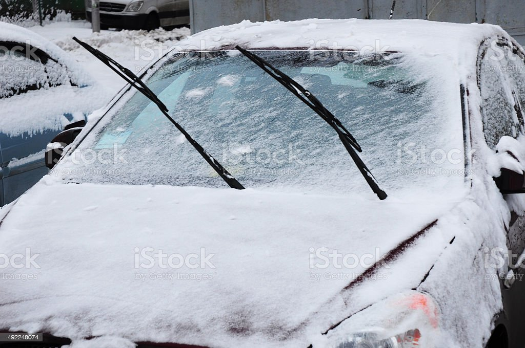 Car in snow in early winter. stock photo