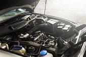 istock Car in the automobile repair shop 1200669692