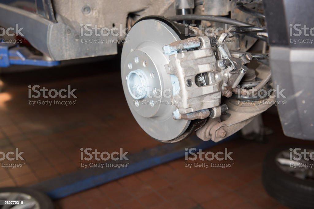 Car in the car repair for the braking repair with new parts stock photo