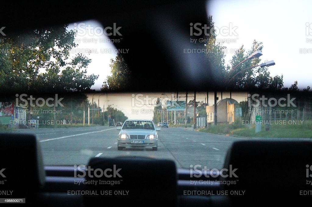 Car in the rear view mirror royalty-free stock photo