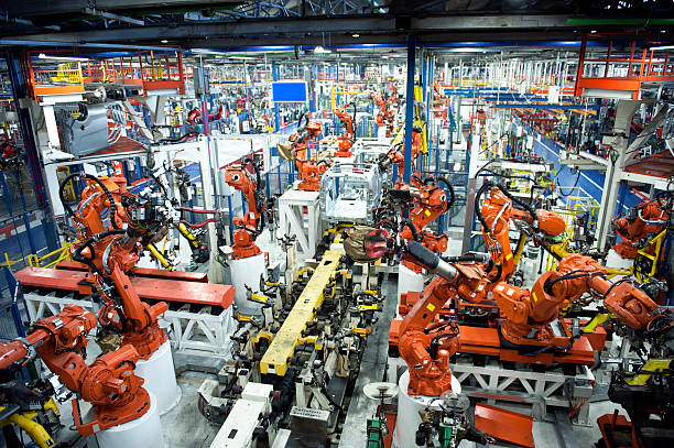 car industry - robotics manufacturing stock photos and pictures