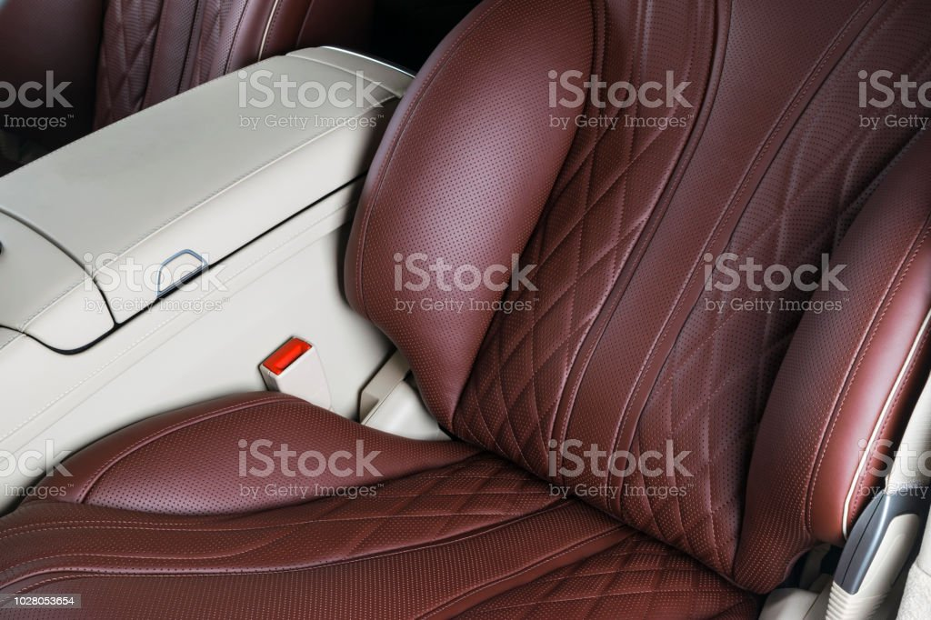 Car inside. Interior of a car. Comfortable leather Black seats. Black...