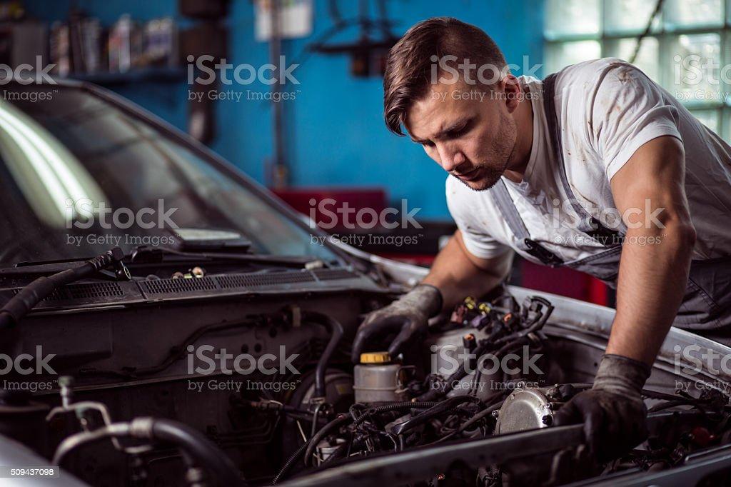 Car inspection at mechanic shop stock photo