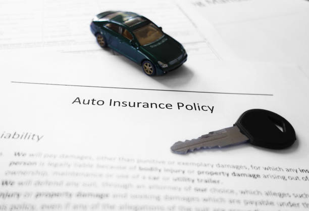 Kfz-Versicherung und Schlüssel – Foto