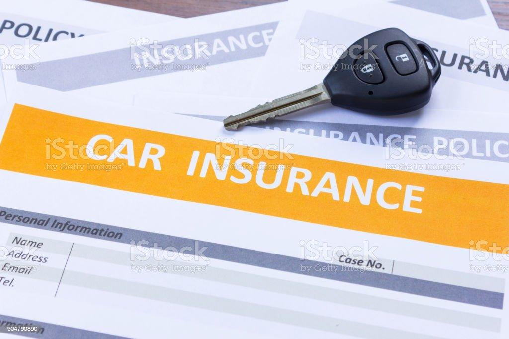 Car insurance form with car key stock photo