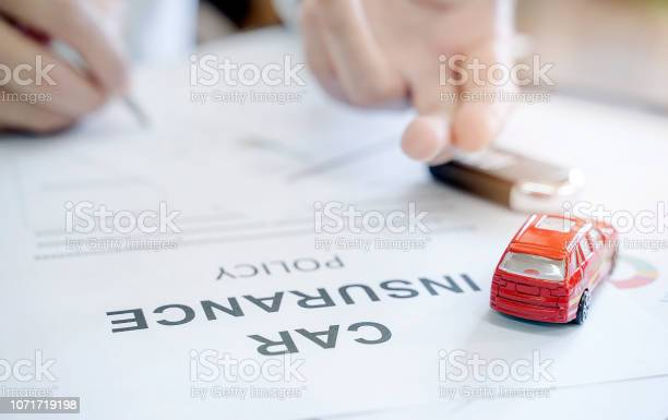 Car insurance policy with red car toy and blur image of man hand picture id1071719198?b=1&k=6&m=1071719198&s=612x612&h=iexld3gtqaplavb8ljfxlf3tugvsaslz2mreys8pwyy=