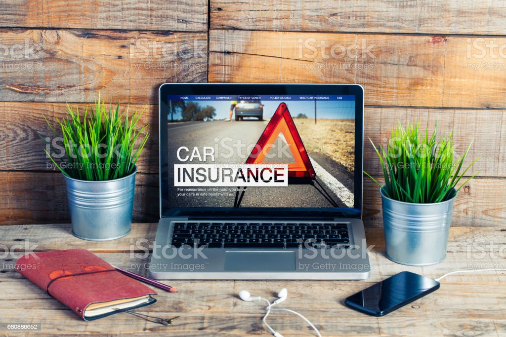 Car insurance website in a laptop screen. royalty-free stock photo