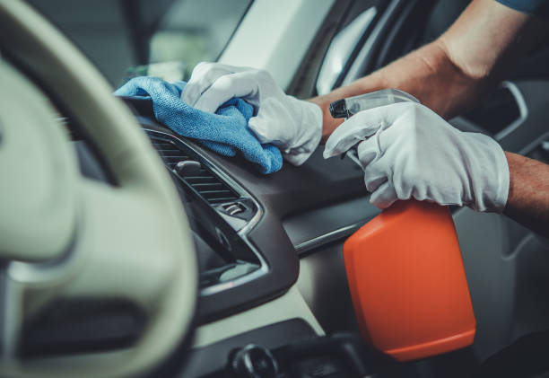 Car Interior Cleaning and Maintenance Using Specialized Detergents stock photo