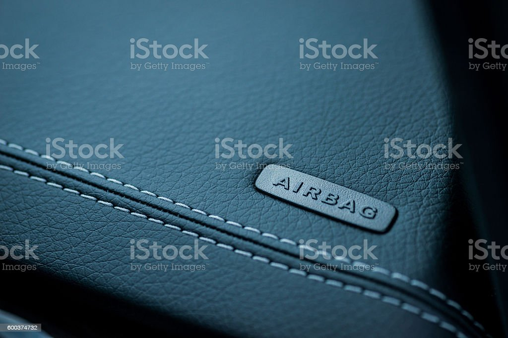 Car interior details. Airbag badge on leather dashboard stock photo