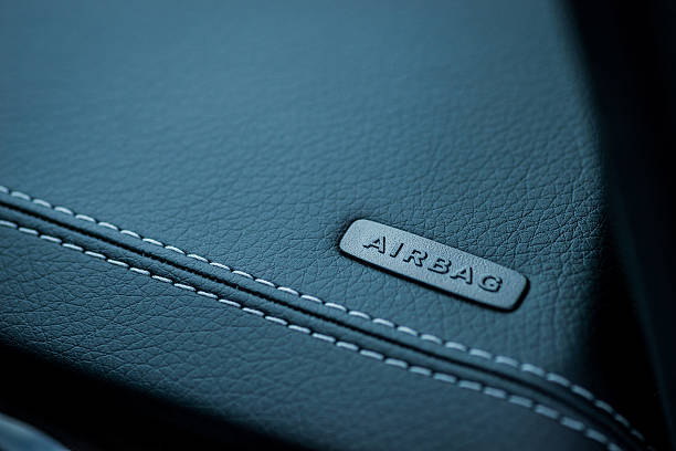 Car interior details. Airbag badge on leather dashboard – Foto
