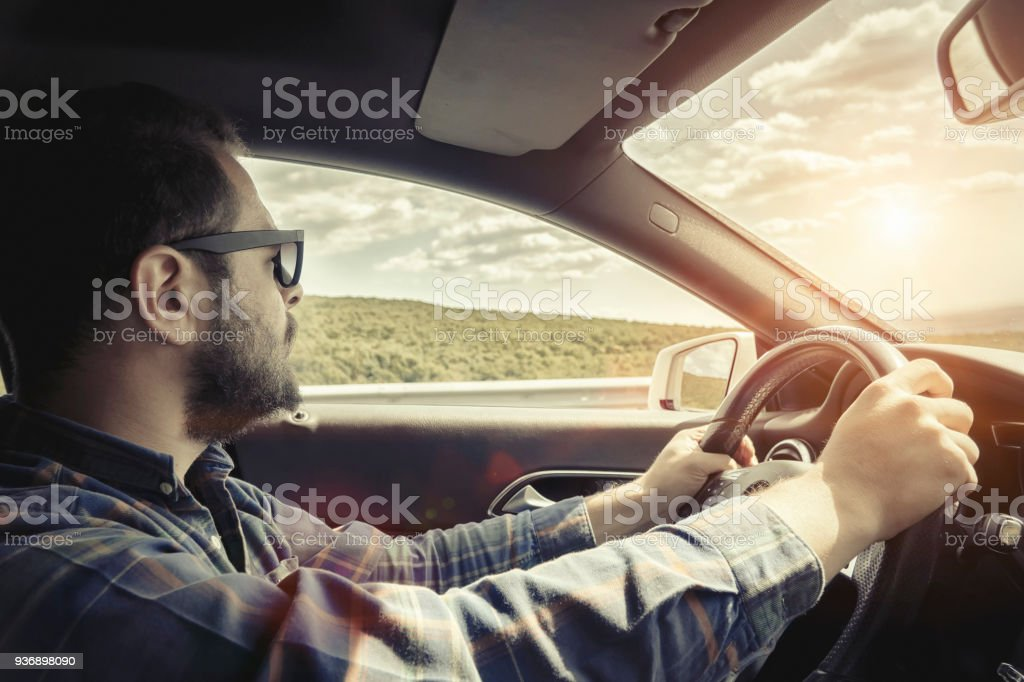 Car interior on the motorway with navigation under sunset stock photo