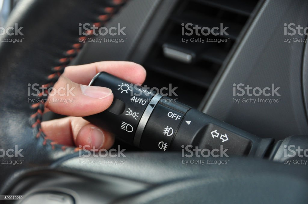 Car interior with light switch stock photo