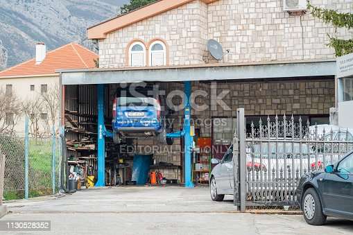 154934986 istock photo Car is on the lift 1130528352