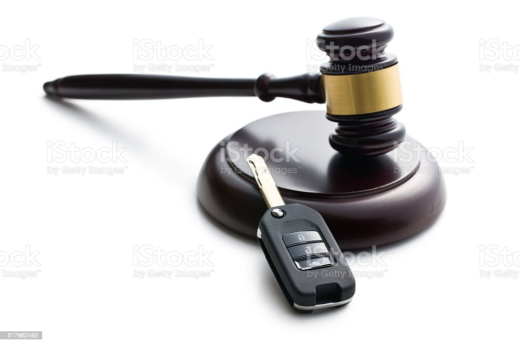 car key and judge gavel stock photo