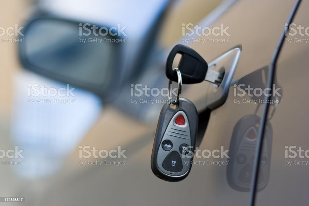 Car Key and Remote in Door of Silver Automobile royalty-free stock photo