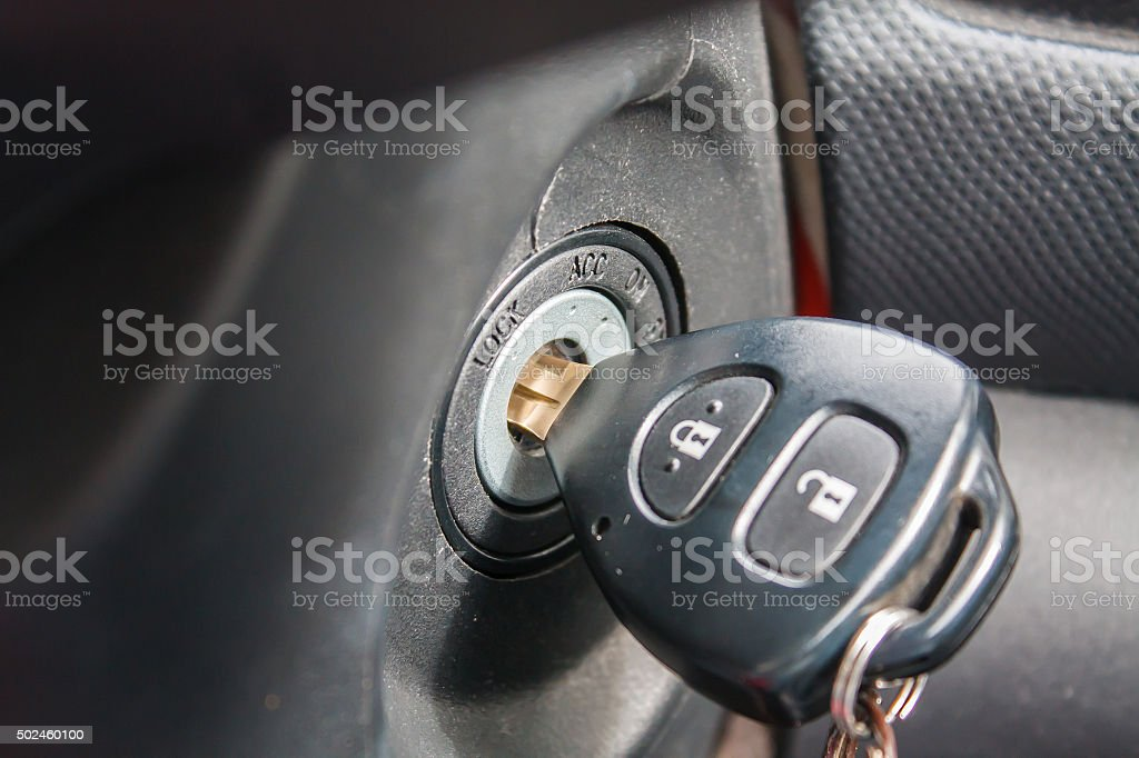 Car key at the keyhole stock photo