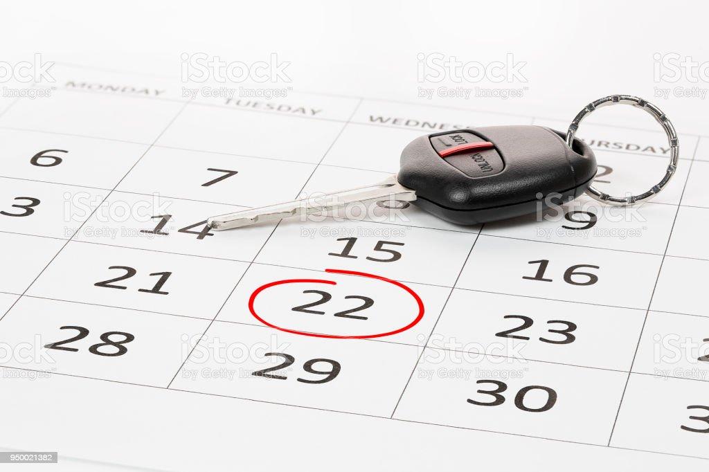 car key on calendar stock photo