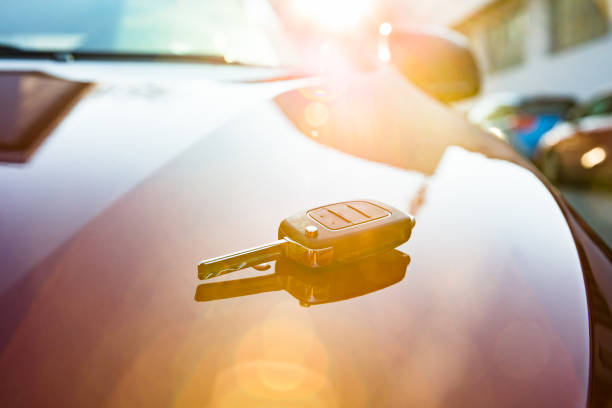 Car Key On New Car Close-up Of A Car Key Placed On New Car car key stock pictures, royalty-free photos & images