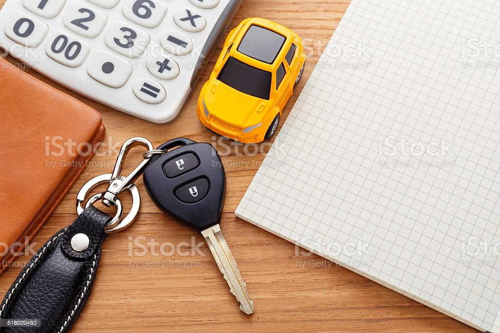 Car key with calculator and pocket money stock photo