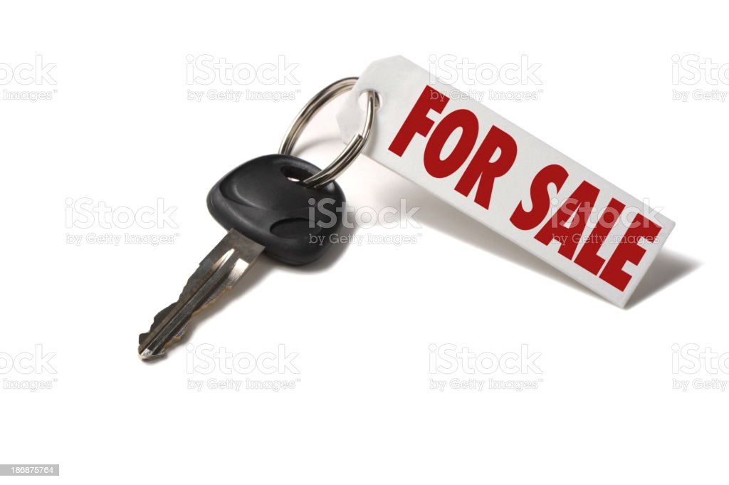 Car Key with For Sale Tag Isolated on White Background royalty-free stock photo