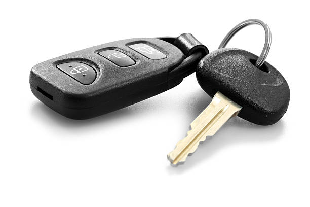 car key with remote control car key with remote control over white background car key stock pictures, royalty-free photos & images