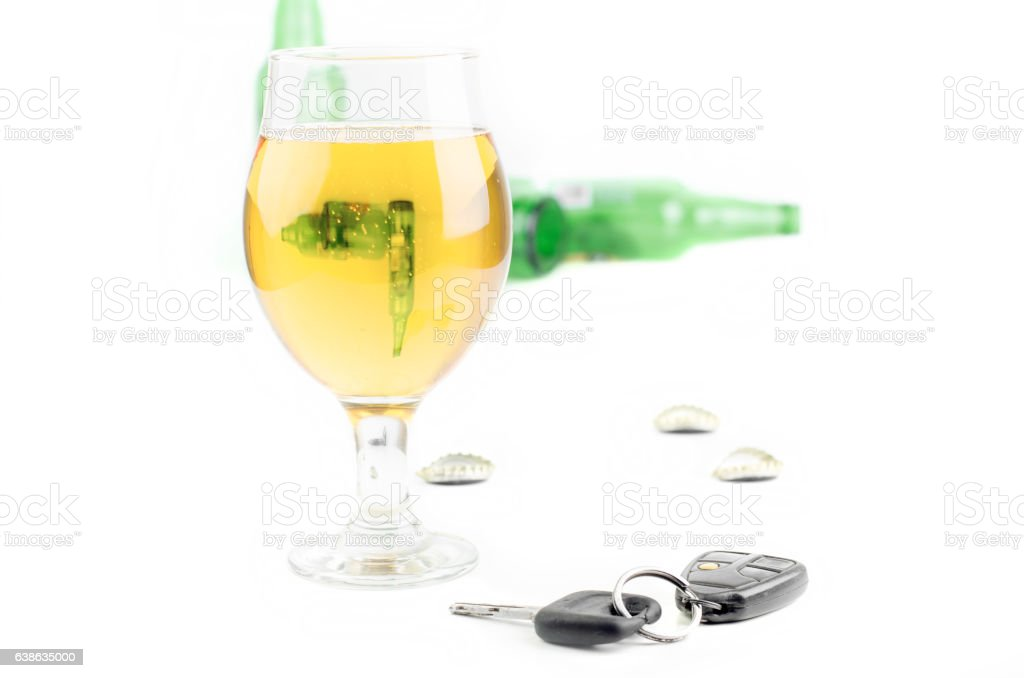 Car Keys And Glass Beer With Empty Bottles stock photo