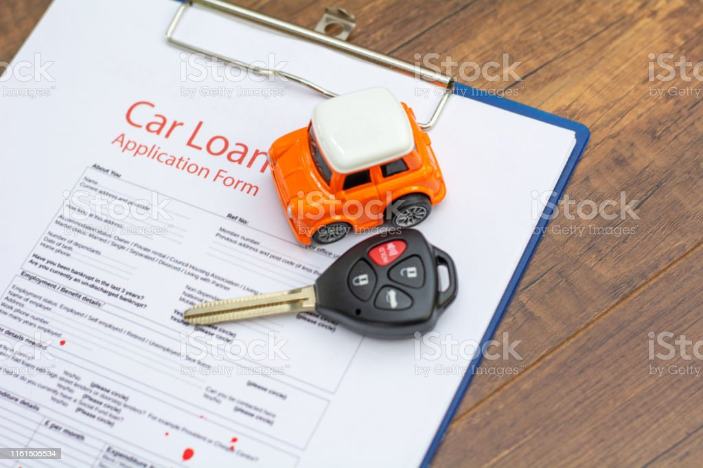 Car keys, car model on the signed agreement document, Buying &...