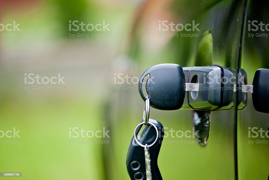 Car keys in a lock stock photo
