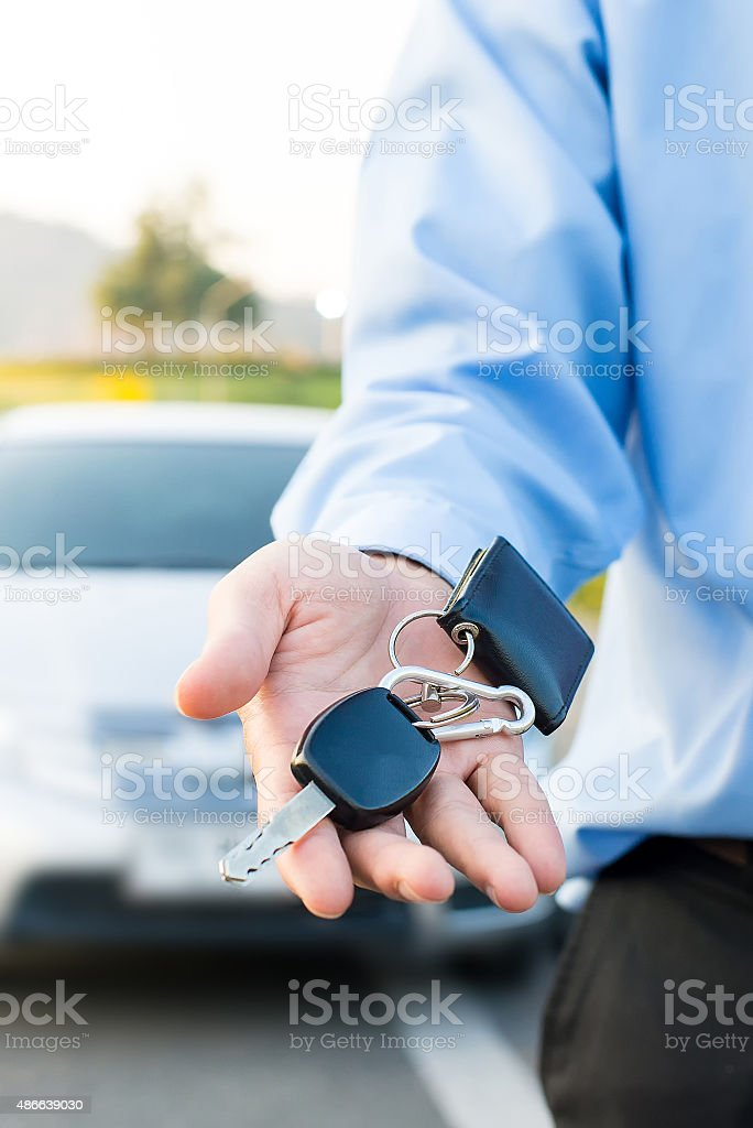 Car Keys. Seller hand giving keys stock photo