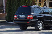 istock Car Land Cruiser Prado from Toyota. The car is parked near the cafe. 937134890