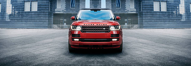 Car Land Rover Range Rover in the city at daytime Moscow, Russia - November 22, 2015: Land Rover Range Rover car parked at the Moscow-City at daytime range rover stock pictures, royalty-free photos & images