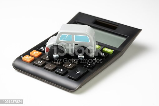 936987338 istock photo Car leasing, rental or insurance and maintenance calculation concept, cute wooden small toy car parking on black calculator on white background, down payment, installment for auto market 1051537824