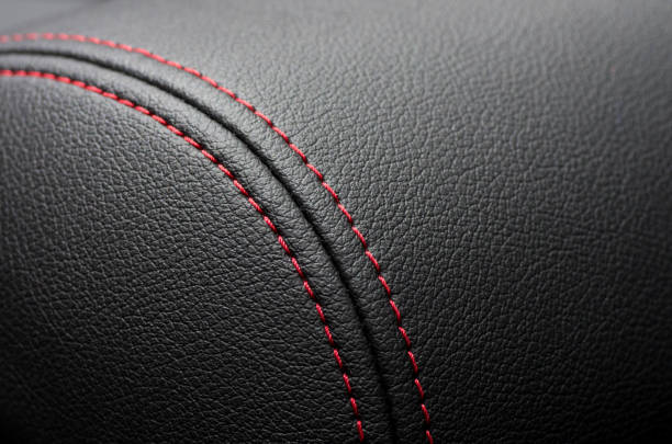 Car leather interior Close up of Car leather interior details with stitch. luxury car stock pictures, royalty-free photos & images