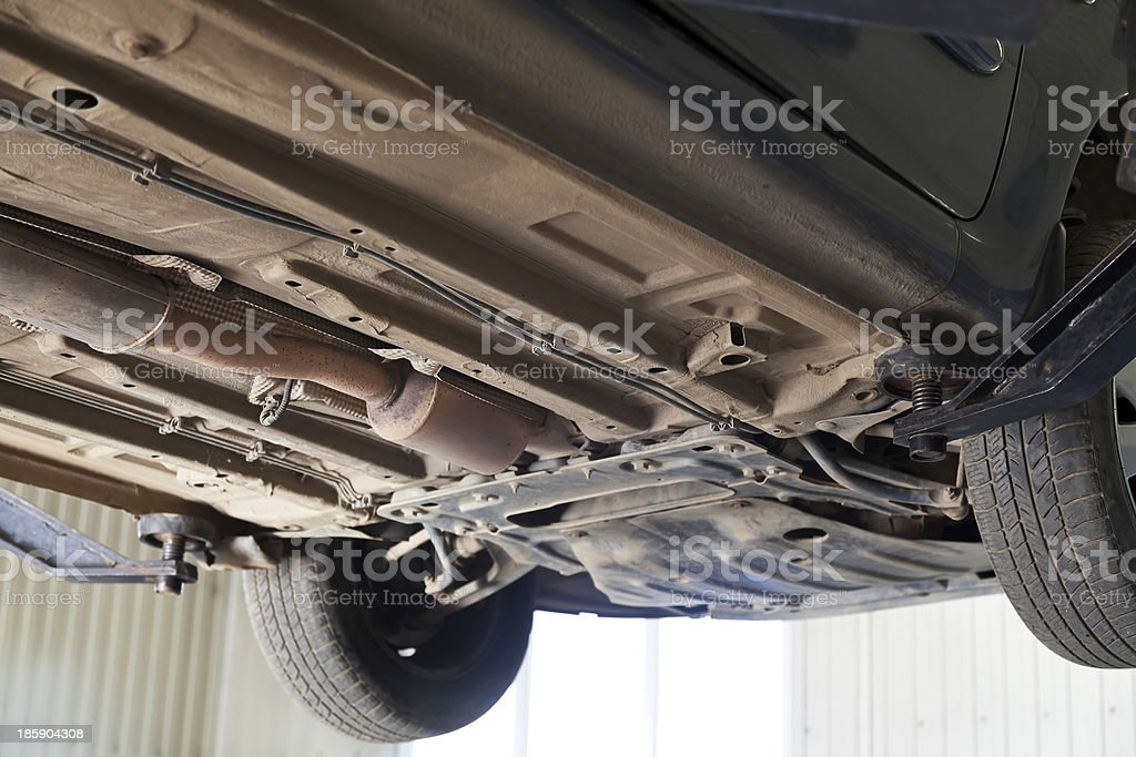 car lifted on auto hoist at service station stock photo